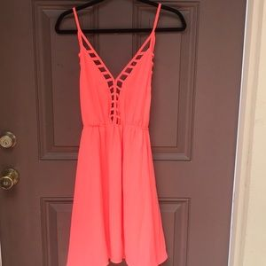 Cute hot pink dress with tie back and caged front